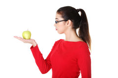 Attractive woman in eyeglasses with apple on hand. Stock Photo