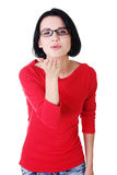 Attractive woman in eyeglasses sending kiss. Royalty Free Stock Photos