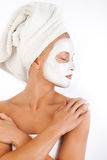 Attractive woman with face mask. Portrait of attractive young woman with face mask after bath Royalty Free Stock Images
