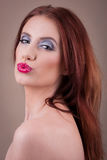 Attractive woman face with pouting mouth Royalty Free Stock Photography