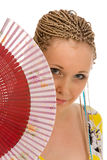 Attractive woman with a fan. Attractive woman concealed by her fan Stock Images