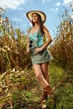 Attractive woman farmer in the cornfield Royalty Free Stock Photos