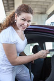 Attractive woman fastening the buckle of child safety seat Stock Photography