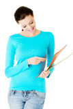 Attractive woman with files. Stock Photos