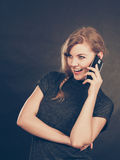 Attractive woman flirting texting on mobile phone. Royalty Free Stock Photos