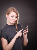 Attractive woman flirting texting on mobile phone. Stock Photos