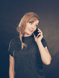 Attractive woman flirting texting on mobile phone. Royalty Free Stock Images