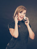 Attractive woman flirting texting on mobile phone. Stock Photography