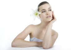 Attractive woman with flower Royalty Free Stock Image