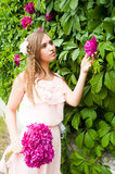 Attractive woman with flower hairstyle Royalty Free Stock Images