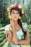 Attractive woman with flower wreath Stock Photos