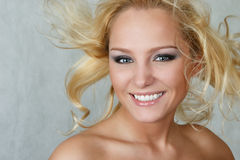 Attractive woman with fly-away hair Stock Photography
