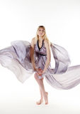 Attractive woman in flying dress Royalty Free Stock Photo