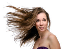 Attractive woman with flying long hair Stock Photo