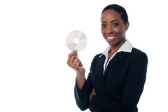 Attractive woman in formals holding CD Royalty Free Stock Photography