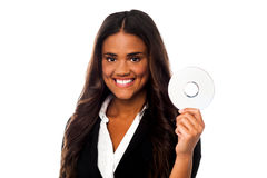 Attractive woman in formals holding CD Stock Images
