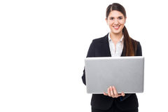 Attractive woman in formals working on laptop Stock Images