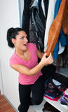 Attractive woman in front of closet full of clothes Stock Photography