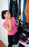 Attractive woman in front of closet full of clothes Stock Photos