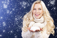 Attractive woman in front of winter background Royalty Free Stock Photography
