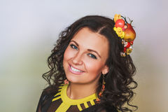 Attractive woman with fruit hairgrip. In autumn style Stock Photography