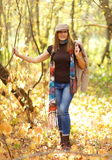 Attractive woman full-length. In a cap in the park Stock Image