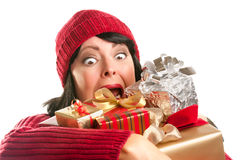 Attractive Woman Fumbling with Her Holiday Gifts Royalty Free Stock Photos