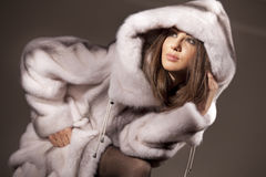 Attractive woman in fur coat Royalty Free Stock Images