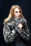 Attractive woman in fur coat Stock Photos