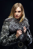 Attractive woman in fur coat Stock Photography
