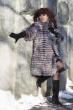 The attractive woman in a fur coat from the silver fox is photog Royalty Free Stock Photo