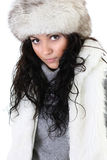 Attractive woman in fur hat. Isolated over white background Stock Images