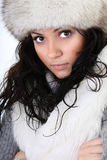 Attractive woman in fur hat. Isolated over white background Royalty Free Stock Photo