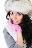 Attractive woman in fur hat. Isolated over white background Royalty Free Stock Image