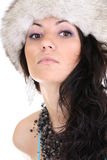 Attractive woman in fur hat. Young attractive woman in fur hat isolated over white background Royalty Free Stock Image