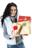 Attractive woman in fur vest with presents Stock Image