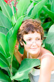 Attractive woman in a garden Royalty Free Stock Photo