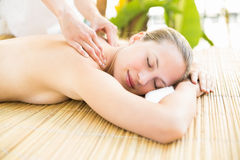 Attractive woman getting massage on her back Royalty Free Stock Photo