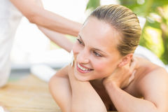 Attractive woman getting massage on her back Royalty Free Stock Photography