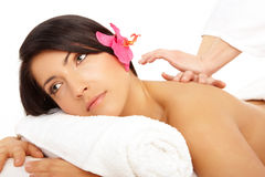 Attractive woman getting a massage in a spa Royalty Free Stock Image