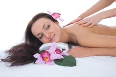 Attractive woman getting spa treatment stock images