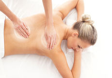 An attractive woman getting spa treatment on white Stock Images
