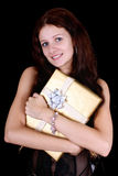 Attractive woman with gift Royalty Free Stock Images