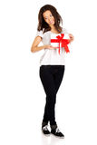 Attractive woman with gift box. Royalty Free Stock Images