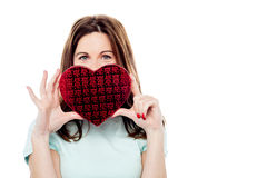 Attractive woman with gift box in form of heart Stock Photography