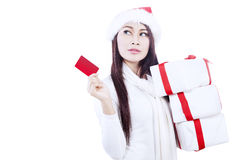 Attractive woman with gift card-isolated in white Royalty Free Stock Photography