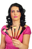 Attractive woman giving brushes set Royalty Free Stock Images