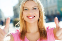 Attractive woman giving thumbs up royalty free stock images