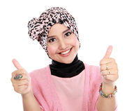 Attractive woman giving thumbs up Stock Images