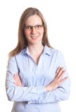Attractive woman with glasses and crossed arms Royalty Free Stock Photo